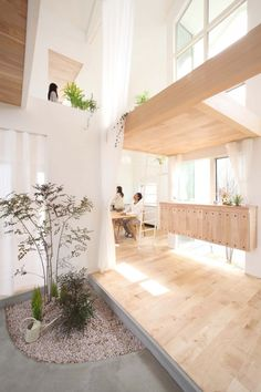 love wood/white and lot of light .. and layering of spaces
