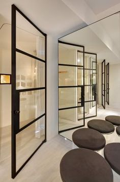 Steel, glass and white ... sleek, simple and strong ONE LARGE SLIDING DOOR IN THIS STYLE TO MATCH FEATURE WINDOW IN ENTRANCE HALLWAY
