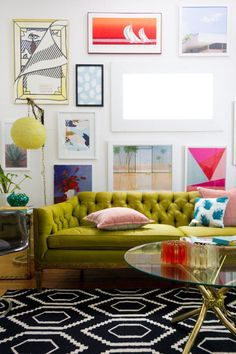 Colorful Living Room Gallery Wall with Green Tufted Sofa