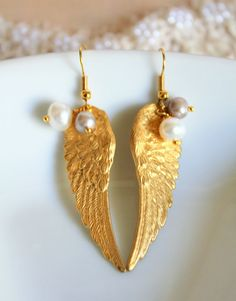 "Angel wings earrings-dangle earrings Victorian shabby chic with real fresh water pearls.  Elegant chic earrings ,2.5"" long.  The Angel wing earrings made of raw brass & real freshwater silver and withe color pearls dangle from them.  The earring hocks are gold plated nickel free ."