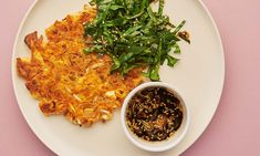 Meera Sodha's kimchi pancakes with a salty-sour dipping sauce and spinach salad.