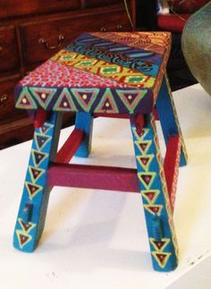 This is a hand painted wood childs stool, display stand or a trivet for your dining room table, picture frame, plant, figurine, candy dish, doll tea table, candle, etc. Use it in any room. It makes a great gift. Wonderful gift for wedding, housewarming, host or hostess, any holiday, boss, co-worker etc. 10Wx8Hx7D Due to different computer monitors/calibrations colors may vary slightly from the picture. Thank you for visiting my shop. Feedback is welcome. Please tell your friends.  See other…