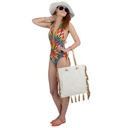 Kenneth Cole one-piece bathing suit, $170, Dillards. Tory Burch double strap rubber sandals, $74, and Loeffler Randall tote, $550, Saks Fifth Avenue. Sun N Sand hat, $24, Dillards. Oliver Peoples mirrored aviator sunglasses, $299, Visions. Stephanie Kantis tassel earrings, $175; Alexis Bittar liquid hinge bangles, $170 each; and Stephanie Kantis large and small 42-inch chain necklaces, $475-$495, Saks Fifth Avenue.