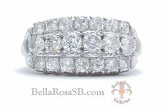 """The Felicity. This white gold diamond band features three rows of round cut diamonds, 20 total, of 2.12 carats total weight. This substantial and scintillating late Art Deco period wedding band could also be considered a statement ring, aka """"right hand ring"""", designed in a wide cigar band style. The center row sits a tad higher and has larger stones that give it a presence not commonly found in the factory made jewelry of today."""
