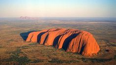 Aerial view of Uluru and the Olgas in the Northern Territories Australia -- Plus, view website to read 100 things you should know about Australia.