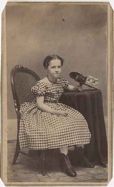 cdv by E. M. Collins of Fulton, New York a young girl holds a Holmes/Bates style stereo viewer