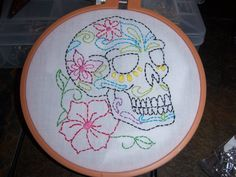 Cool day of the dead embroidery from Craftster.