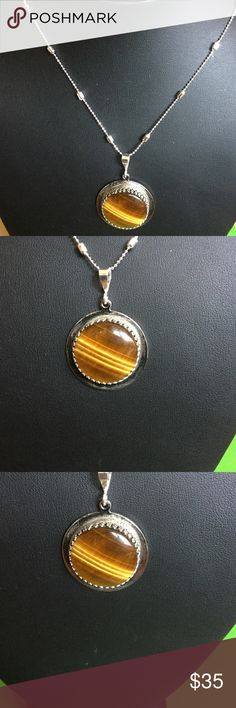 """Handmade Tiger'sEye Sterling Silver Pendant A-5-1 .925 Sterling Silver bezel holds a beautiful 25mm (1.06"""") Natural Tiger's Eye Cabochon. This is a handmade on of a kind piece. Includes a 20"""" chain. Handmade by HM Simon Jewelry Necklaces"""