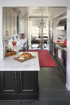 The only way I'd ever have a galley kitchen is of it were at least this wide. Transitional Galley Kitchen With White Marble Countertops Kitchen Flooring, Kitchen Trends, Galley Kitchen Remodel, Kitchen Remodel, Modern Kitchen Trends, Home Kitchens, Kitchen Layout, Galley Kitchen Design, Kitchen Renovation