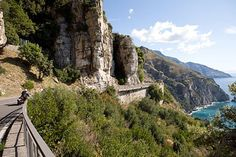"""Glimpsing the Amalfi Coast for the First Time    As you descend the Nastro Azzurro (""""Blue Ribbon"""") road that runs over the mountain from Sorrento to Positano, gives a taste of what it is to embark on one of the world's famous coastal drives. The scenery becomes increasingly dramatic as the blue sea glistens far below.    Photo Caption: The winding stretch of coastal road between Sorrento and Amalfi is one of Europe's classic drives.    Photo by Raffaele Capasso"""