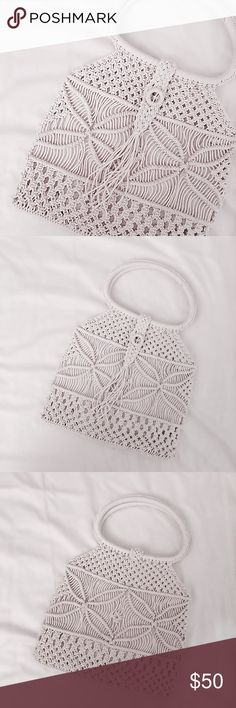 """'70s """"Sadie"""" Macrame Handle Bag Handmade woven macrame bag, probably from the 1970s. Off white/cream color with white linen lining, button closure. Kept in great condition. 10""""x10.5"""" w 4""""handle drop. Pair with jeans and a white tshirt. Approx value $80. Vintage Bags"""