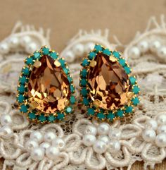 Hey, I found this really awesome Etsy listing at http://www.etsy.com/listing/123161497/turquoise-champagne-crystal-big-teardrop