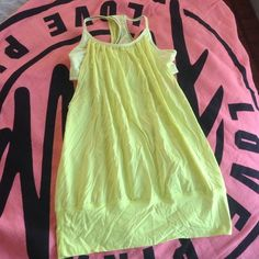Lululemon yellow green no limits tank Lovely and light! Worn once for a race–perfect condition except for a small stain at back hip where my gel belt was causing me to chaffe during the race. Size 6. **no PayPal or trades, please.** lululemon athletica Tops Tank Tops