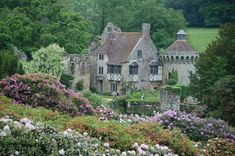 https://flic.kr/p/MuPv2 | May 26 Scotney Castle (4) | Scotney Castle Lamberhurst, Tunbridge Wells, Kent Victorian country house set in one of England's most romantic gardens surrounded by a beautiful wooded estate One of England's most romantic gardens  Ruined 14th-century castle in a tranquil lakeside setting  Unusual heather-thatched ice house  Superb displays of rhododendrons and azaleas   Designated one of the 'Seven Wonders of the Weald'