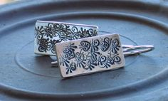 Sterling silver dangle earrings with leaf engraving by anakim, $45.00