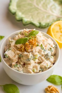 A creamy but healthy basil chicken salad with fresh basil and chopped walnuts - great as a sandwich, wrap or lettuce wrap, or paired with crackers!