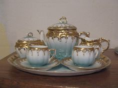 Antique German Doll Tea Set - Teapot, Sugar bowl, creamer two cups and saucers and matching tray