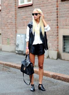 monochrome street style in leather shorts and gilet