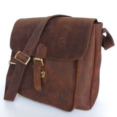 (Leather Messenger Bag / Ipad Satchel) Hey, I just realized I could carry around a takedown bow in something like this and tell people it's for my tablet!...