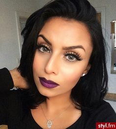 Simple eye, heavy lashes and a purple lip. Love it! ACW