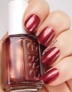 essie Wrapped in Rubies | Be Happy And Buy Polish http://behappyandbuypolish.com/2016/01/08/essie-wrapped-in-rubies-swatch-review/