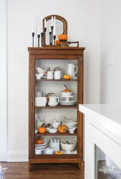 Fall Decorating in My Dining Room #fall #decor #decorating #diningroom #styling Vintage Fall Decor, Black Bowl, Vintage Sideboard, Fall Candles, Extra Storage Space, Vintage Chairs, Fall Decorating, Wood Cabinets, Autumn Inspiration