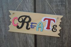 Create an inspirational sign with colorful letters