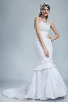 Russian Queen by Olia Zavozina. Mermaid gown featuring ruffle on sweetheart neckline and above skirt.
