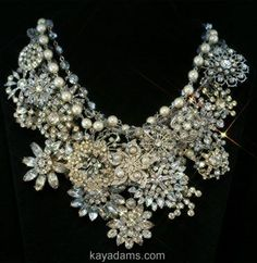 Vintage brooch necklace...this would be fabulous to wear for your wedding reception...Why change dresses, just change your necklace.