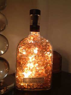 Do Make Wine Bottle Lights | ... bottle with colored marbles and lights | How to Make A Bottle Lamp