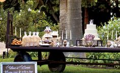 Get creative with not only the dessert offerings but the display! This vintage wagon was converted into a dessert bar and decorated with candlesticks and lanterns to maintain the vintage feel. l TheKnot.com