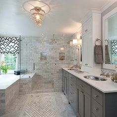TamaraMackDesign bathrooms - gray bathroom, gray cabinets,charcoal gray cabinets,shaker cabinets,gray shaker cabinets, charcoal gray shaker cabinets, double bathroom vanity,gray double bathroom vanity, white framed mirrors, calcutta marble, calcutta marble tiles, calcutta marble shower, seamless glass shower, rain shower head, drop-in tub, patterned roman shades, marble floor, marble inset tiles, bathroom sconces, bathroom