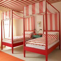 Red bedroom with twin striped beds | Colourful bedroom ideas | Bedroom | PHOTO GALLERY | Homes & Gardens | Housetohome.co.uk