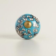 A cheerful addition to any door, our hand-painted ceramic doorknob features a fresh flower-inspired motif and a bright nickel-plated fitting.