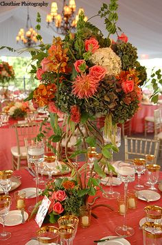 Coral rose and green hydrangea centerpieces on a vine vase designed by Stoneblossom
