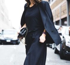 There is a lot of power in a completely black outfit, but how to pull off an all black outfit on the right way? The golden tip is to mix textures, if you pick a leather trousers combine it with a chunky knit!