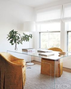 Lucite desk and antique silk chairs