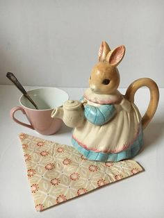 Vintage Teapot, Mrs. Rabbit Pitcher, Beatrix Potter Style Home decor, Decorative Tea Pot, Ceramic Bunny Teapot with Handle, 2 piece Blue and White pitcher. Adorable teapot or milk pitcher for Springtime or all year round! Pitcher Teapot is shaped like a mother rabbit holding a