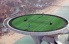 """""""Rafael Nadal and Roger Federer playing an exhibition tennis match in 2005 on the helipad of the Burj Al Arab hotel in Dubai. The court is 700 feet off the ground.""""   - photo by EPA, via Daily Mail"""