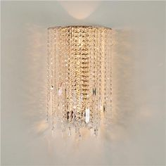 """Crystal Drape Sconce Crystal Drape Sconce: Dazzle your guests with this elegant crystal sconce! Sparkling crystal strands drape from a chrome frame creating a dramatic display. Assembly required. 4x60 watts. (20""""Hx11""""Wx6""""D)"""