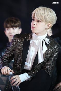 Jimin being sexy drinking water  Also is that Chanyeol in the back round?