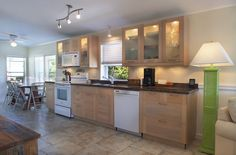6800 Maloney Avenue, #110, in Key West offers spectacular open water vistas, world famous sunsets, and kayaking from your own backyard.  The updated kitchen has gorgeous cabinets and granite countertops.