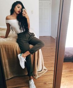 Street style, casual outfit, spring chic, summer chic, white off shoulder top, green pants, Stan Smith Adidas sneakers