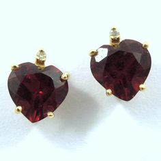 Heart Shaped Stud Earrings set in 14K Yellow Gold with Diamond Accents. - $225