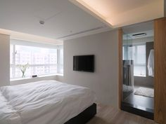 Asian Apartment by WCH Interior - White bedroom
