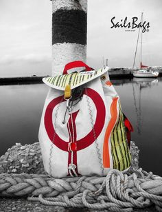 """This Back Pack is made with three different sailcloth. One is from Genoa furling boat Oceanis 461 Beneteau 1999. The main furling has """"decommissioned"""" in 2003. It has been estimated that the miles that sailing trips is about 8000-8500 nm. The second is from cloth OPTIMIST 2008, has a participated in the national championship 2008. Has donated the Nautical Club of Thessaloniki. And the third one, is patch from main sail 3DL from sailing boat ElliniXX 40."""