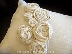 More pillow ideas. Drop cloth pillow with rolled flower. Going to make these in a variety of colors for Gwendolyn's bed.  #http://inkblotsandpolkadots.blogspot.com/2011/03/drop-cloth-rosette-pillow.html