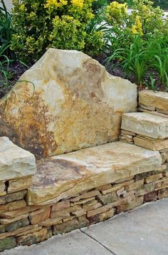 """I like the """"dentist chair"""" seat, and the chatty details about stone bench installation. (stone around pool backyards) Exterior Wall Design, Stone Retaining Wall, Retaining Walls, Rose Garden Design, Wall Seating, Wall Bench, Corner Bench, Patio Wall, Seating Areas"""