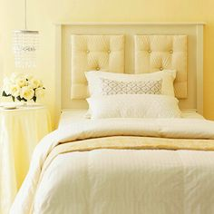 Neutral Guest Bedroom ~ This monochromatic room is bursting with understated elegance. The warm and cool tones of yellow harmonize to create a crisp and classic space that will keep in style throughout the years.    What We Love: A low-hanging beaded chandelier works well in place of a based lamp. The small crystals will look beautiful when lit up at night and be equally as stunning during the day.