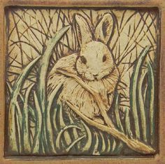 Carved tile . . .rabbit in grass . . .